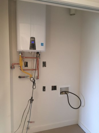 Utility room with tankless water heater