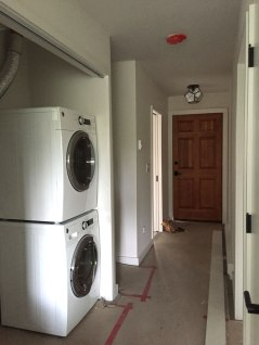 New washer and dryer in the utility room and new hallway light fixture added